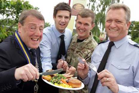Adam Simpson (second from left) from Crown Carveries presents a carvery to (l-r) Veteran Andy Greg, WO2 Ian Collins (Army) and W01 Dennis Hawkins (RAF)