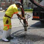 Pothole-Fixing 'JetPatcher' Machines To Stay In County